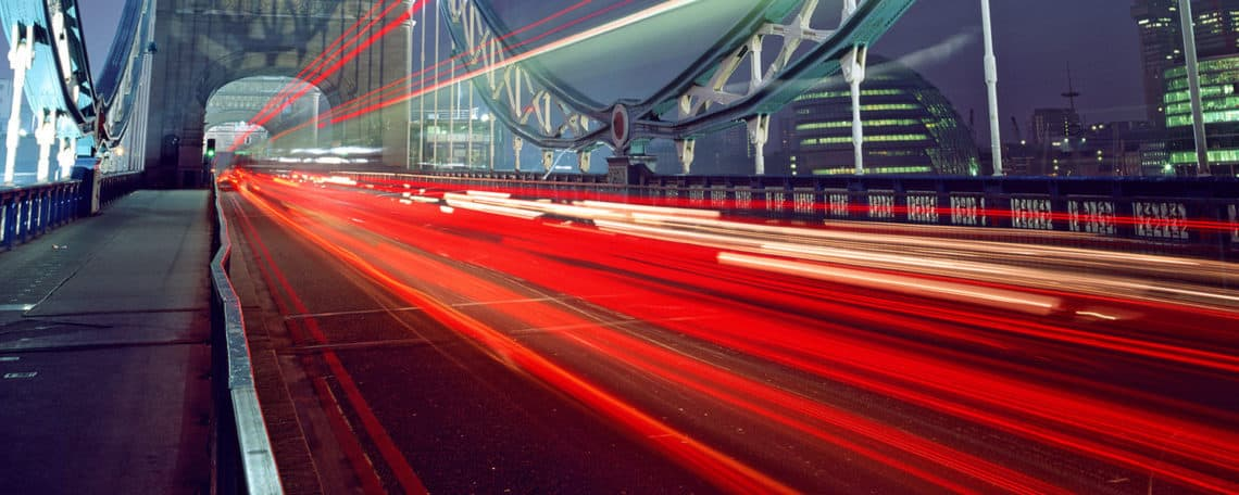Streaks of light from cars passing over Tower Bridge at night., Tower Bridge, London, London, England.